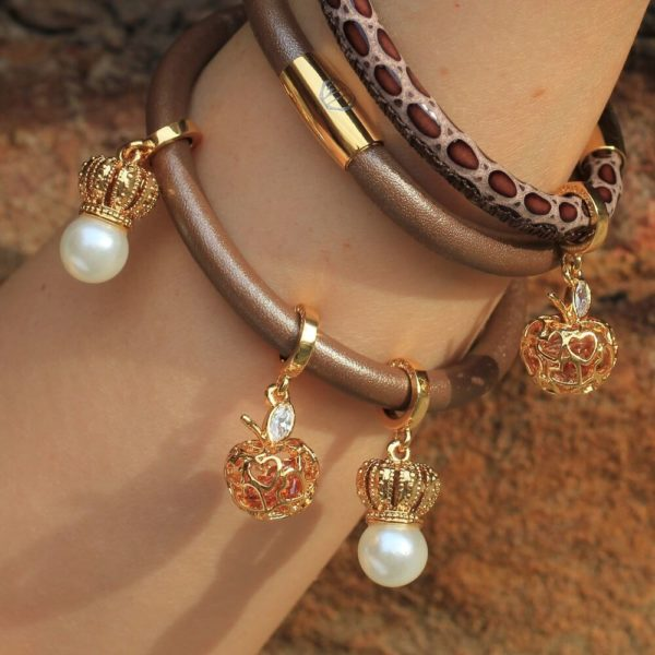 Bronze Bracelets and Gold Charms